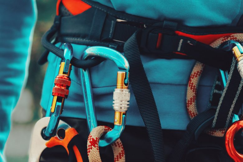 Close-up,Detail,Of,Rock,Climber,Wearing,Safety,Harness,And,Climbing